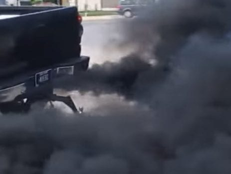 Black Diesel Ute blowing black smoke out of the exhaust