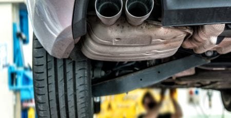 car on mechanics hoist