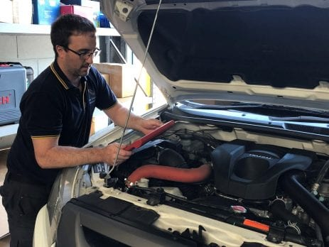 Diagnostic injector testing being completed on a Isuzu work vehicle