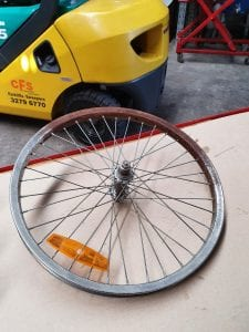bicycle rim soaked in rust remover liquid